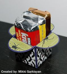 """Here I used the Petal Card Punch, which I cut 4 of them and combined them to create a little box and than used the 1"""" square punch to decorate the sides and for the top, I used a 1"""" circle punchand cut in half. DSP used is Frightful Sight."""
