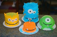 Monsters - Made these cakes for my sons 1st birthday. Monster Theme.  Round green monster covered in fondant w/ fondant arms and legs.  All other monsters covered in BC.