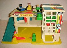 Fisher Price Garage. I HAD ALL THE FISHER PRICE TOYS - MY MOM STILL HAS THEM ALL :))