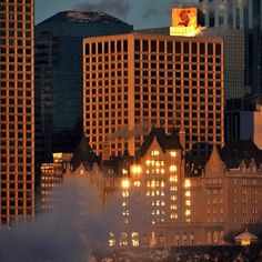 home- The rising sun reflects off of downtown buildings in Edmonton, Alberta on Dec. 19, 2012. Photo by John Lucas/Edmonton Journal