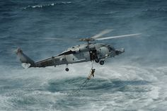 Ladder recovery from a Sea Hawk helicopter. by Official U.S. Navy Imagery