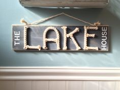 The lake house sign - nautical rope sign - lake house decor - nautical sign - lake life - lake house gift The Lake House! A charming addition to YOUR lake house! This sign would look fantastic in any room! Created using scrap cotton rope to spell out LAKE, it measures approx 20 x 5 1/2 and has a distressed graphite finish. Prefer a different background color...just ask!  Signs are handmade to order so there may be some slight variations from the one pictured. They are intended to be rust...