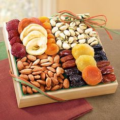 AP8000 Pacific Coast Classic Dried Fruit Tray Gift An assortment of popular dried fruits with fresh almonds and pistachios in-the-shell, arranged to perfection in charming wooden tray with carved handles.