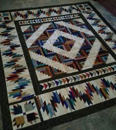 http://www.quiltingboard.com/pictures-f5/retreat-project-completed-bear-mountain-cabin-t271687.html