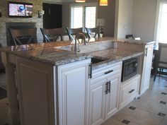 Chiefswood - Classic kitchen with modern touches.   Two-tiered island hides mess.  Granite hood vent cover, double wall ovens with warming drawer, two sinks and a custom doggie drawer at the bottom of the island to hide messy bowls.  Second Wind Interior Design Portfolio