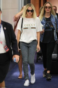 Show your brand allegiance in a Gucci logo t-shirt like Margot #DailyMail Click 'Visit' to buy now #gucci #margotrobbie #jetsetter #celebritystyle #celebrities