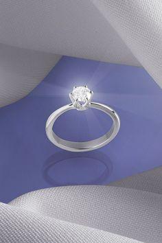 Diamantový zásnubný prsteň Janette je citlivo vyšpičkovaná klasika, ktorá sa už niekoľko rokov drží na vrchole predajnosti medzi našimi zásnubnými prsteňmi. V čom spočíva jeho úspech? Rafinovaný detail v podobe zúženej šíny pri diamante necháva perfektne vyniknúť centrálnemu briliantu, ktorý sme ručne osadili do šiestich krapní. Janette je presne ten typ prstienka, ktorý je nadčasový vo svojej jednoduchosti a bude v každej dobe moderný i žiadaný. Ako sa páči vám? Diamond Engagement Rings, Jewelry, Diamond, Jewellery Making, Jewlery, Jewelery, Jewerly, Engagement Rings, Diamond Engagement Ring