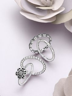 Create an elegant and modern stack with sterling silver rings and lace-work flowers. #PANDORA #PANDORAring
