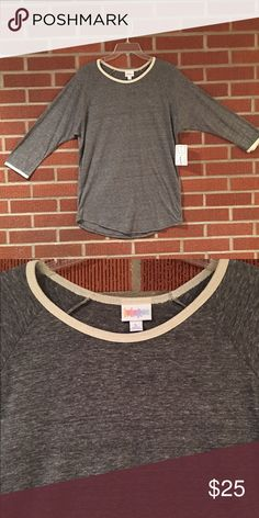 LuLaRoe Randy Shirt Heathered grey with pale yellow trim along the neck and sleeves 3/4 length sleeve baseball style shirt. Very soft and comfortable. 50% Polyester/38% Cotton/12% Rayon. LuLaRoe Tops