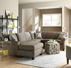 This long sectional sofa is an ideal choice for family sized entertainment spaces. A family room sectional, this piece features five seats. It has a chaise lounger that allows one to place their feet up and has a unique shape that is at home against walls or in open areas. Its look is clean and decorative with rounded arms, wooden feet and welt cord trim. (Throw Pillows May Not Be Included with Leather Version).
