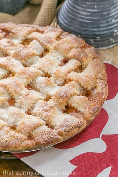 Classic Peach Pie | A flaky lattice crust topping sweet and juicy peach filling #SundaySupper