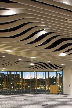 High Profile Series™ Vertically Curved Baffles ceilings bring a wave of beauty to the Jacobs Medical Center at UC San Diego Health. #FluentInDesign Commercial Interior Design, Commercial Interiors, Certainteed Siding, Baffle Ceiling, Dragon Pattern, False Ceiling Design, Decorative Trim, Medical Center, Interior Walls