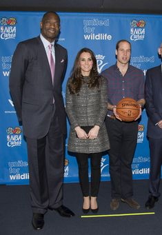 NBA Global Ambassador Dikembe Mutombo, Catherine, Duchess of Cambridge and Prince William, Duke of Cambridge at Barclays Center on December 8, 2014 in the Brooklyn borough of New York City.