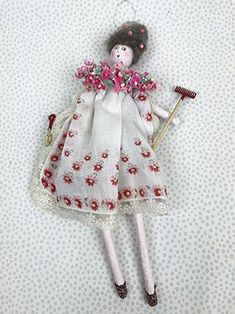 Some people like to garden in their favorite dresses and wear pearls whist digging the garden bed. Go figure. I made this lovely lady out of bits of vintage materials and added touches of wire and glitter and of course, a plethora of flowers! Her dress is a pretty vintage hankie and she is really digging it! (Pun intended) Alpaca fluff for her beautiful hair with little pink beads to add to her ornamental beauty. She is about 11 inches high and is filled with lavender so just give her a…