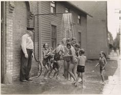 Children cool off from summer heat outside a Connecticut firehouse, April 1935 (Luis Marden, National Geographic) National Geographic, Old Pictures, Old Photos, Moving Pictures, Harmony Of The Seas, We Are The World, Summer Heat, Summer Fun, Summer Days
