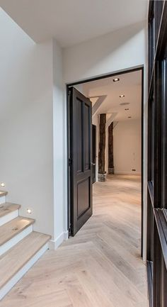 High black doors with beautiful parquet flooring laid on the tra . High black doors with beautiful parquet flooring laid on the stairs. Dark Doors, House Design, Interior Stairs, Interior, Home, Wood Doors, Doors Interior, House Interior, Stairs Colours