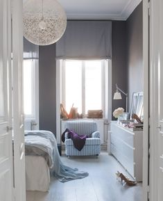 Fresh and Clean: 30 Scandinavian-Inspired Rooms via Brit + Co. [Cool, light gray for master bedroom]