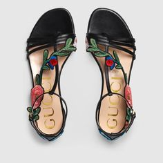 8bec3a35303 Embroidered leather sandal by Gucci.