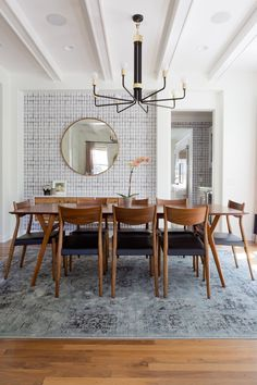 Vintage modern dining room. Photo by Amy Bartlam. Design by Veneer Designs.