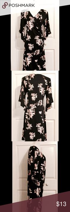 """JBS Faux Wrap Kimono Sleeve Cold Shoulder Dress Amazingly comfortable pullover dress with kimono sleeves, cold shoulder openings, and a faux wrap/ruched at the side detail. Black with cream colored abstract flowers that have light pink accents. Polyester spandex blend. Bust is 18"""", measured flat, but is STRETCHY. Waist is 15"""", measured flat. Length is 38"""" from the shoulder. JBS Dresses"""