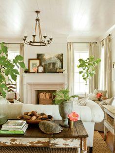<arrangement of furniture around fireplace>