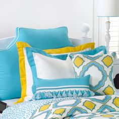 LeighDeux's Aqua Headboard Pillow allows you to sit up in comfort in bed at home and in your dorm. It can be monogrammed in the twin and queen sizes.