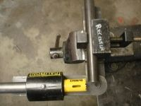Homemade tube notching jig intended to utilize hole saws to create the cuts. Jig consists of two flat bars joined by a pivot bolt. Homemade Tube, Drill Press Stand, Steel Stock, Garage Workshop, Tools, Welding, Bullet, Projects, Yellow