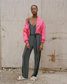 """A sleeveless stripe jumpsuit. Body: 100% viscose, Lining: 72% viscose/28% silk, Combo: 100% silk Slim fit, full-length 33.5"""" inseam Waist tie, silk trim CN 100% VISCOSE Fully lined Dry Clean Imported"""