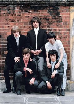 The Rolling Stones...this picture kinda reminds me of the Beatles one where they're suited up against a blue brick wall