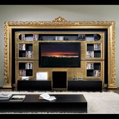 OMG! Build a wall for TV with wires etc behind and frame it with an ornate frame!  Why did I not think of this before!!! <3