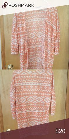 Tribal cardigan Salmon colored, tribal decorated cardigan. Sleeves go about 3/4 down my arms. I love this cardigan but I never use it anymore. It wears well with a dress or leggings or whatever you like ?? Sweaters Cardigans