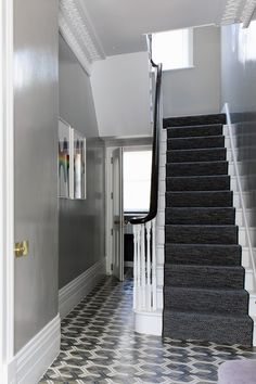 Popham cement tiles. Hardwick white gloss by Farrow and Ball. Foyer entry cement tiles.