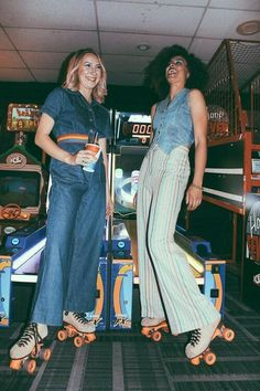 Ladies on roller skates with oldie flared pants. Are they playing those arcade games like that?