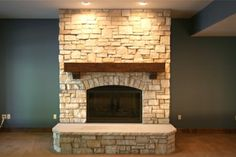 Gorgeous stone fireplace in this lower level Regency home.