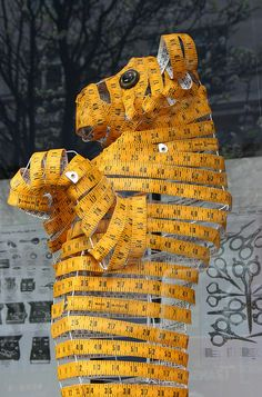 Tape-measure tiger : surreal window display Selfridges by pomphorhynchus, via Flickr