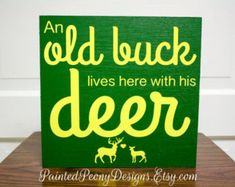 Wood sign saying: An old buck lives here with his deer   Vinyl home decor, cabin decor, Father's Day gift, hunting, hunter, John Deere