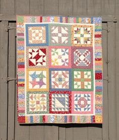 By Material Girl Quilts, a 30's sampler quilt, Gorgeous!! I'm not often a fan of samplers, but she's chosen such wonderful fabrics and colors that I love it. The border adds so much also.