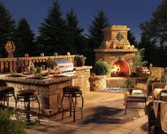 nice fireplace, bbq and dining bar set up