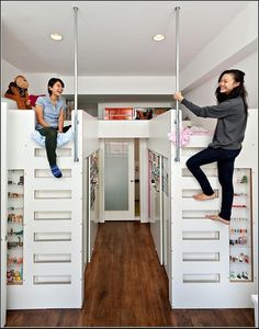 Loft beds with walk-in closet space underneath for a shared, two-girl bedroom