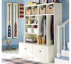 entryway built in huge drawers for shoes and a quick clean up!