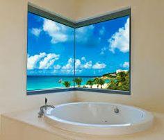 Amusing bathroom design with beautiful sea views