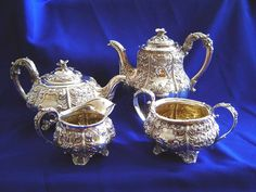 Georgian Sterling Silver Tea and Coffee Set from Richard William Atkins & William Nathaniel Somersall of London, circa 1825.    The set consists of coffee pot, tea pot, cream pitcher and sugar/waste bowl. It is decorated in a lavish repousse' floral / foliate design w/ thick relief and good clear matching marks on all pieces (coffee, cream & sugar on the body; tea pot on the bottom) including lids and handles. Each piece is flanked on either side with a blank stylized cartouche and no…