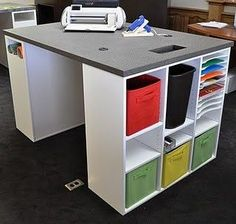 """Craft Desk, loving the garbage """"hole"""" in the countertop for paper scraps! and the cutouts for power cords. Looks easy enough to hack by myself"""