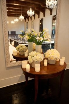 Tall Cala Lilly paired with low hydrangea arrangements candle accents