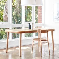 Designers Nicholas Karlovasitis and Sarah Gibson created a pair of wooden tables for DesignByThem that aim to welcome everyone.
