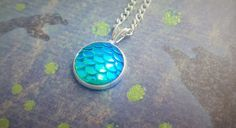 A gorgeous iridescent scales necklace, perfect for mermaid or dragon fans! Girly meets myth and magic these necklaces are eye catching and truly beautiful! Match your inner mermaids tail with this lovely fantasy theme pendant. Why not layer it with other ocean theme jewellery? 10 Colour Options Available! ☆ Would you like a coupon? ☆ Use FREESHIP15 for Free Shipping to the UK when you spend £15! Use FREESHIP30 for Free Standard Shipping Internationally when you spend £30! ☆ Want to see more…