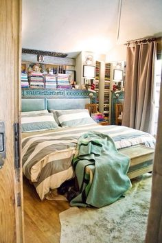 Love the shelving behind the bed. hmm.