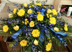 of M casket cover. Maize and blue flowers. Perfect for any University of Michigan fan. Wedding Ceremony Readings, Wedding Ceremony Decorations, Daisy Wedding Flowers, Funeral Flowers, Yellow Roses, Blue Flowers, Gerbera Daisies, Wedding Games For Kids, Casket Sprays
