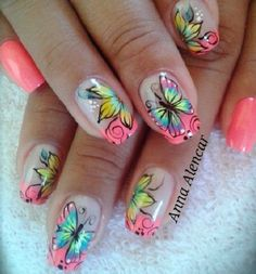 A fully multi colored butterfly nail art design. An explosion of colors to the eyes, this design is simply breathtaking as the butterfly wings take the form of various color combinations.