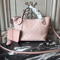 Buy LOUIS VUITTON Replica of top quality from China - Hina PM Mahina Leather is exclusively of top original order quality. Lv Handbags, Luxury Handbags, Louis Vuitton Handbags, Lv Bags, One Bag, Vuitton Bag, Calf Leather, Soft Leather, Fashion Bags